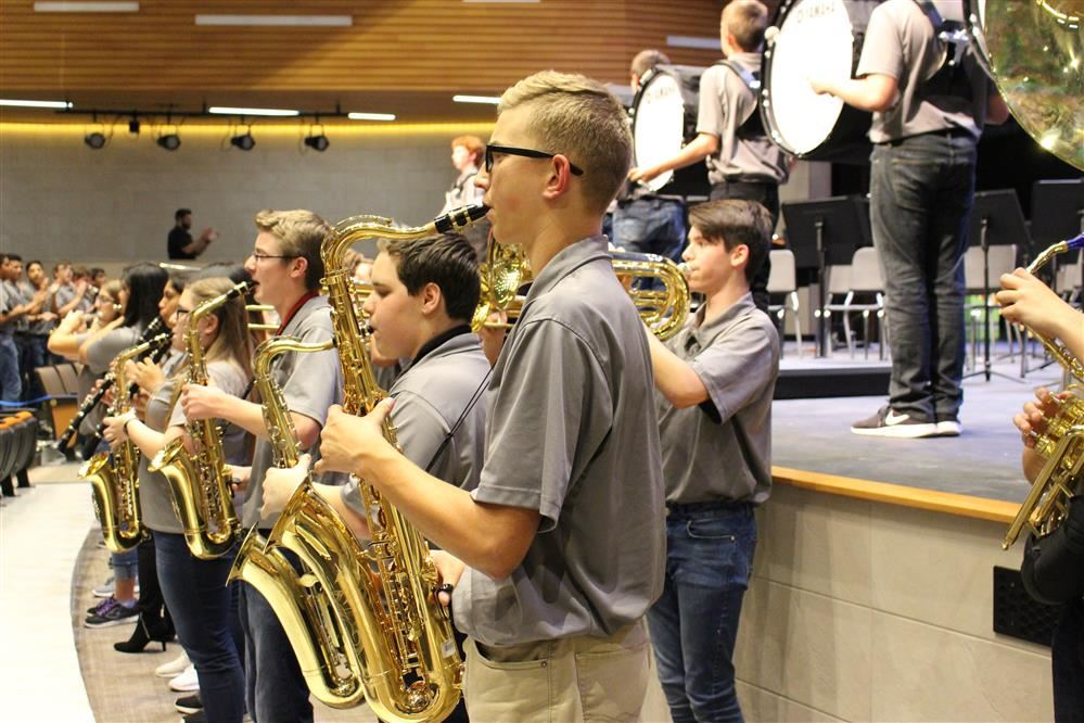 Marching band members perform in front of the crowd during their first concert.