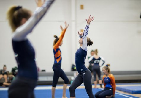 Olathe West Varsity Gymnastics team warms up alongside Olathe East