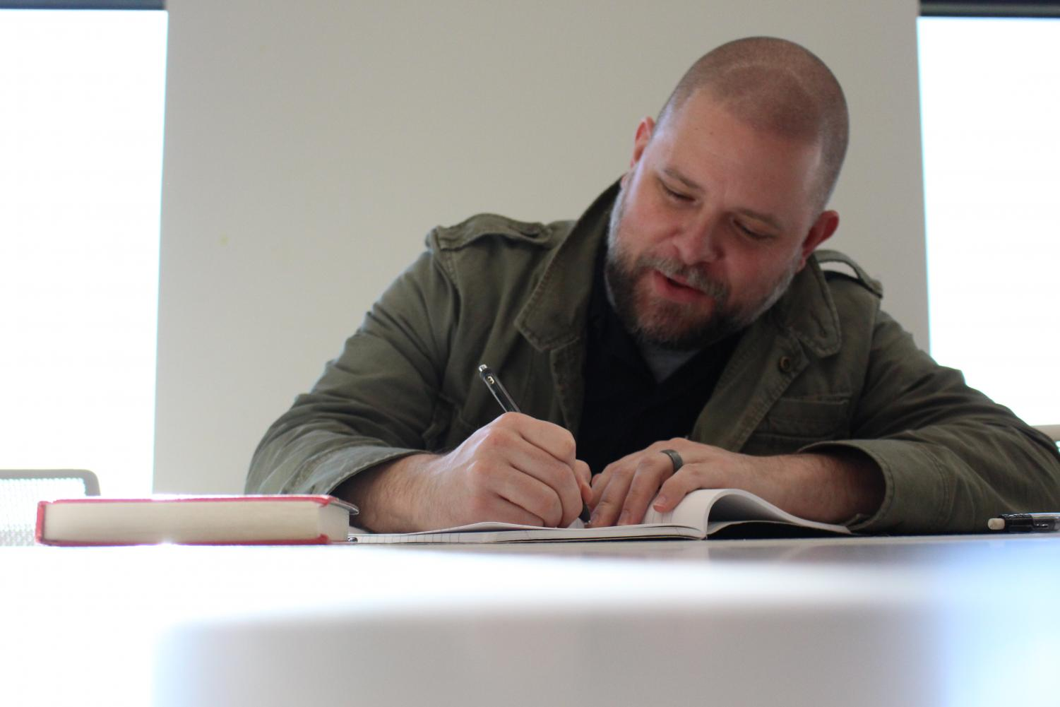 Aaron Schwartz writes in a composition notebook.