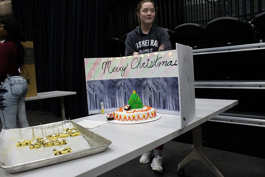 One+of+the+Cake+Wars+competitors%2C+Mckenzie+Gorgon+a+sophomore+at+West%2C+made+a+Christmas-themed+cake.+Their+presentation+featured+a+Christmas+tree+on+top+of+the+one-layer+cake.%0A