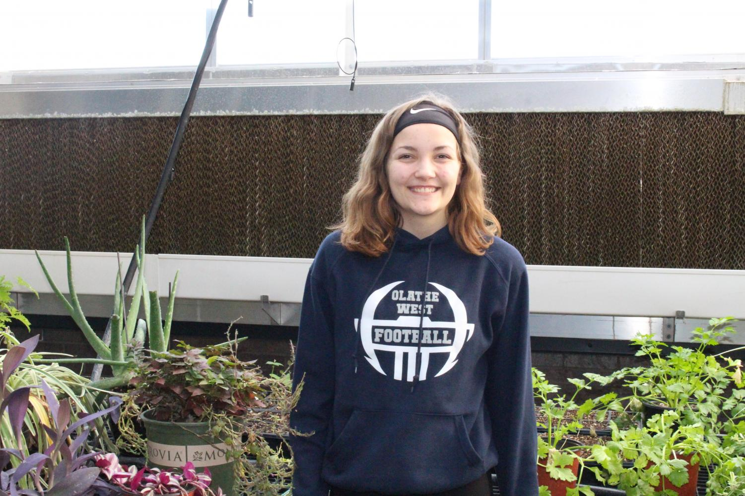 Sophomore Katie O'Keefe appears in Olathe West Green house where her inspiration for the activity was sparked.