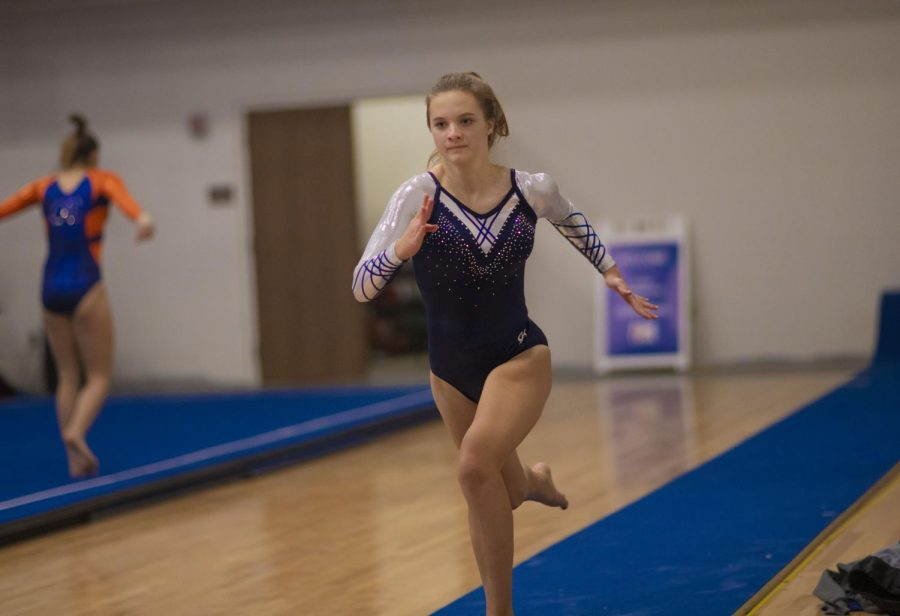 Junior Ava Huntoon gets a running start before jumping into her last competition of the night, the vault.