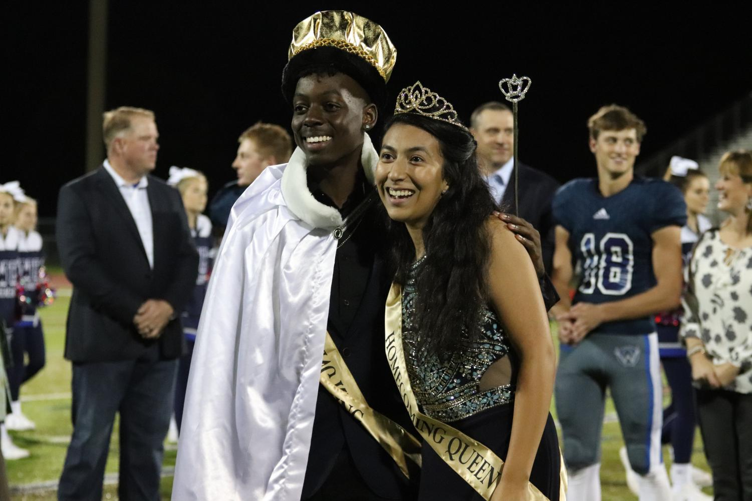 Homecoming King and Queen Austin Curry and Donna Garcia pose for pictures after being crowned.