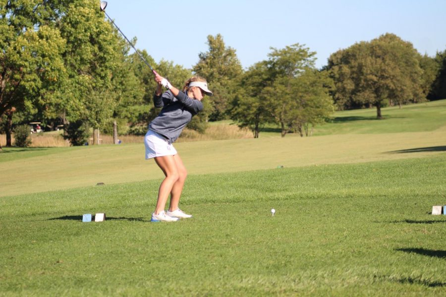 Kendall Starcevich practicing her swing getting ready to tee off on hole one of the course.