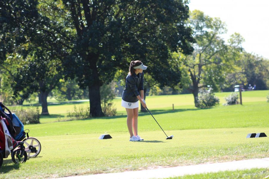 Lyons practices her swing before she tees off on the second hole of the course.