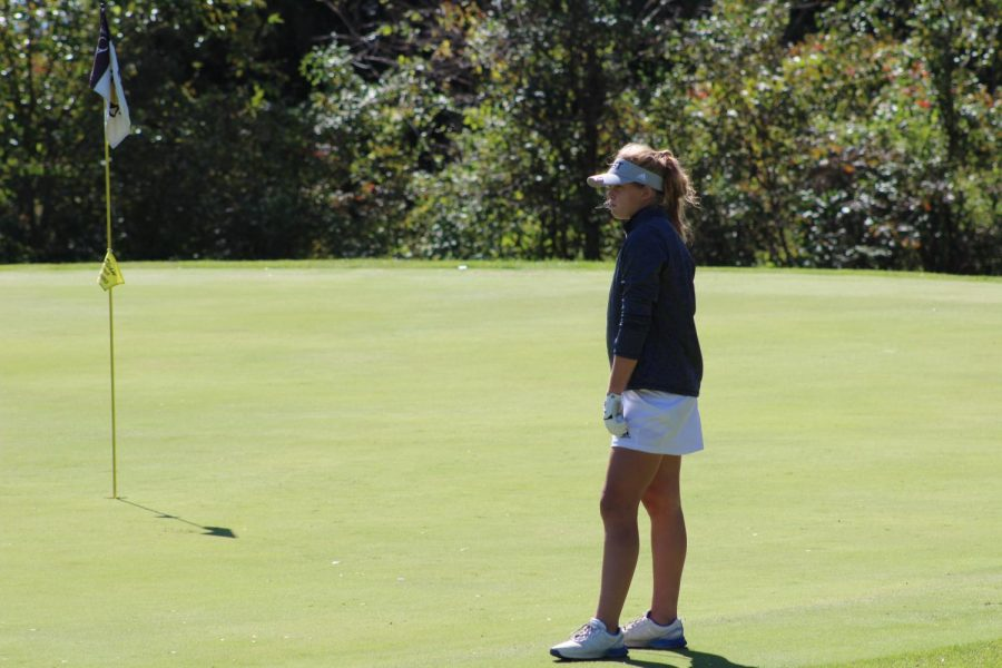Sophomore Kendall Starcevich waits for her turn to hit again on the ninth hole of the course.