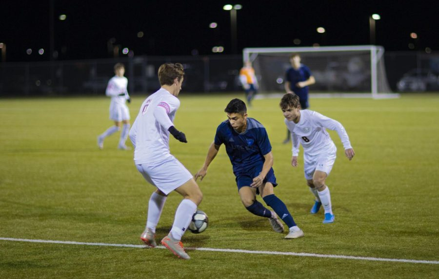 Junior Nicco Lopez tries to steal the ball from his opponent.