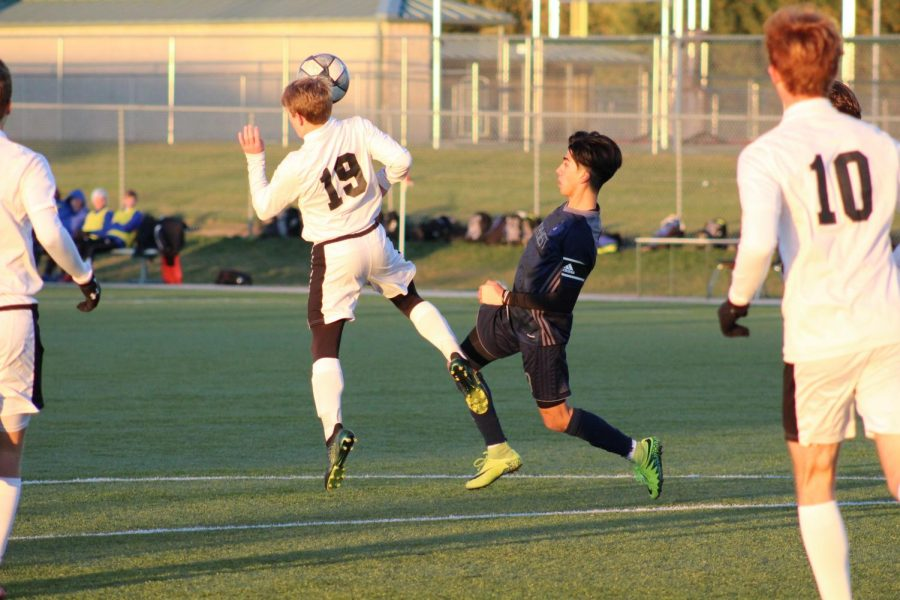 Senior Jony Munoz goes after the ball trying to gain possession.