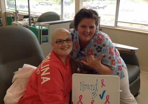 Angela Holtgraves smiles with a nurse after undergoing her  third round of chemotherapy.