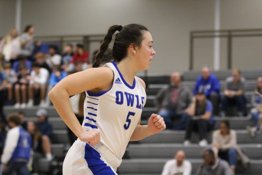 Maddy McGavran runs down the court during the home basketball game on Dec. 13.