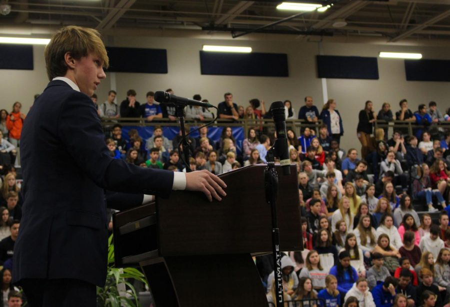 Junior Tyler Stephens speaks to the faculty and student body on the importance of community service at the Dec. 11 Give a Hoot assembly.