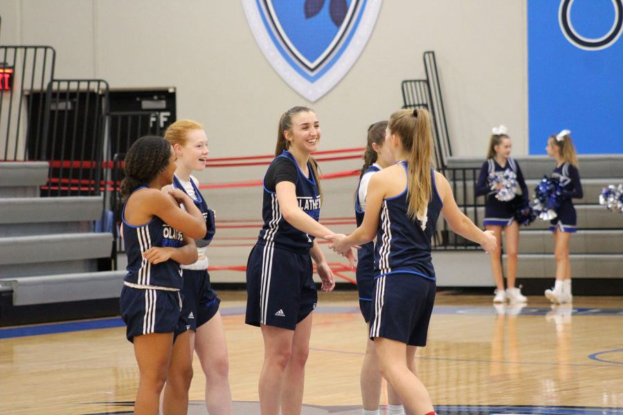 Junior Sydney Loveless, Junior Michelle Anderson, Junior Mackenzie Hart, and Senior Anaiya Uhde walk out on the court as their names are announced before the game starts.