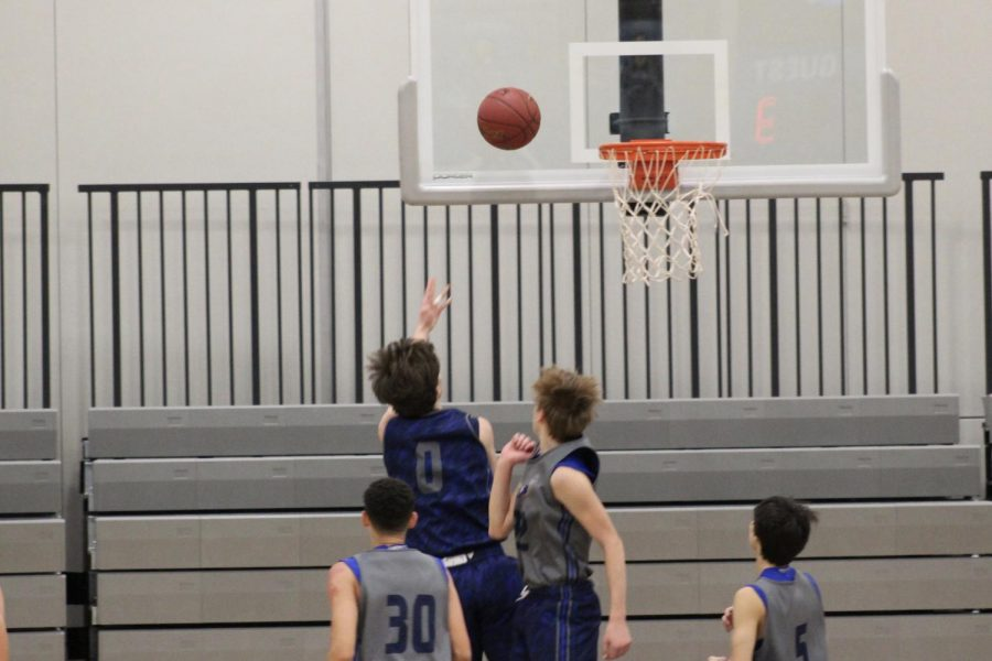 Senior Matt Eastman goes for a layup right after the second half starts.