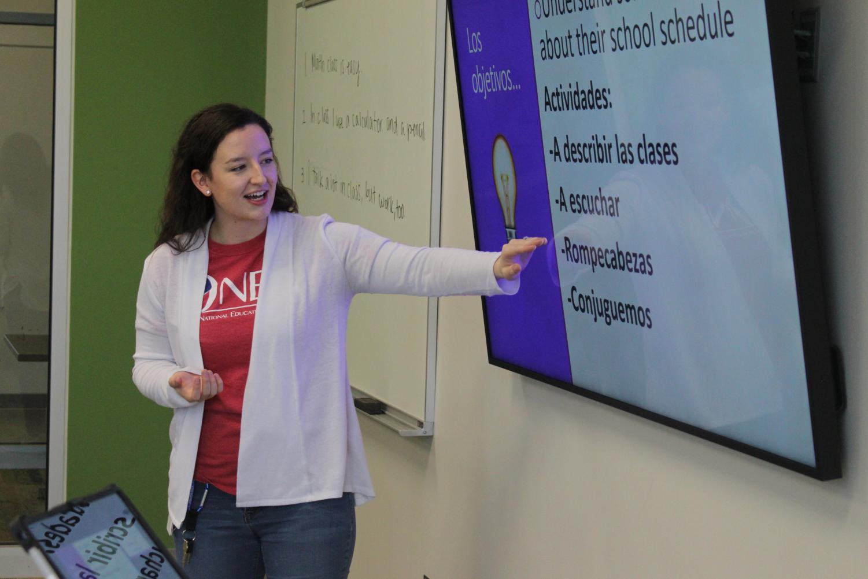 Spanish teacher Anna Nondorf teaches her spanish one class to speak about their classes.
