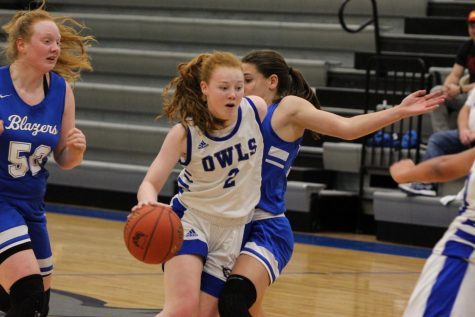 Junior Mackenzie Hart drives towards the basket to score a layup.