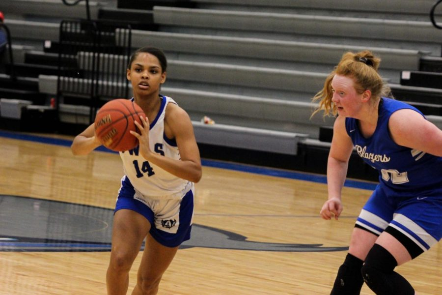 Senior Ashley Gibson passes the ball to one of her teammates.