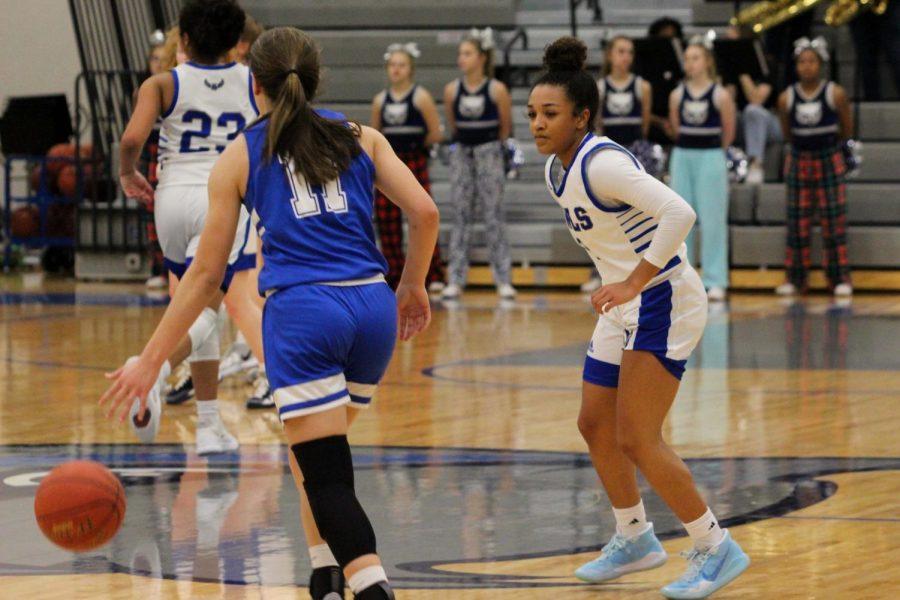 Junior Allysa Moore follows the ball down the court.