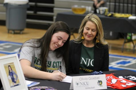 Senior Olivia Goebel signs to play volleyball at New Jersey City University alongside her mother. Her brother, sister and father were also in attendance.
