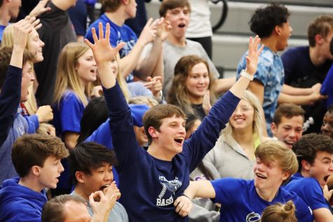 The student section cheers on boys varsity during their senior night game against Olathe North.
