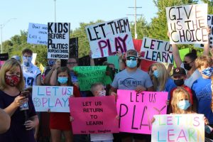 Parents and students protested to support in-person education and to continue fall sports before the Sept. 3 board meeting.