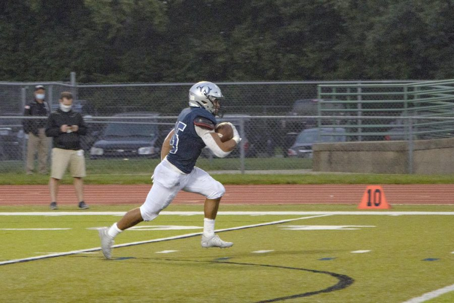 Junior Anthony Favrow runs down the field to score the first touchdown for the Owls.