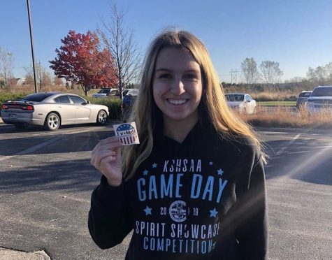 Senior Haley Hahn shows off her 'I voted' sticker that she earned on election day.