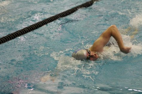 Junior Connor Shepherd reaches the fall preparing for a flip turn during the 200 meter freestyle.