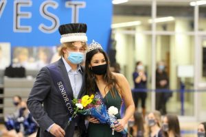 Birge and Bailey Andrade pose for pictures after being crowned senior king and queen at halftime.