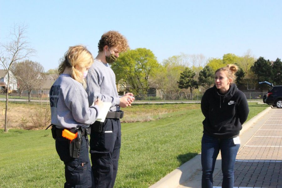 Seniors Summer Sperke and Bobby Wimpey ask their suspect several questions after apprehending her and placing her in hand cuffs.