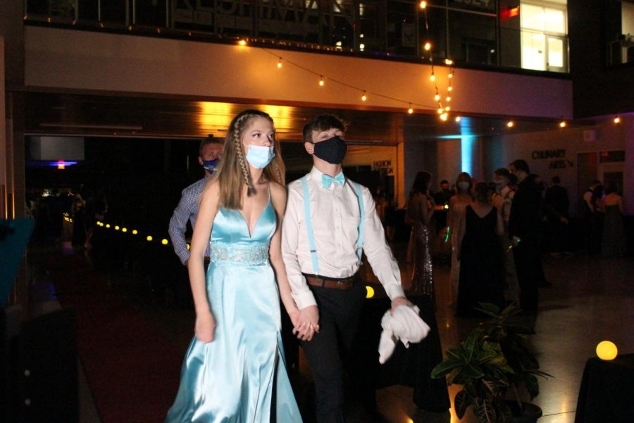 Faith Ehrsam and her date arrive at prom.