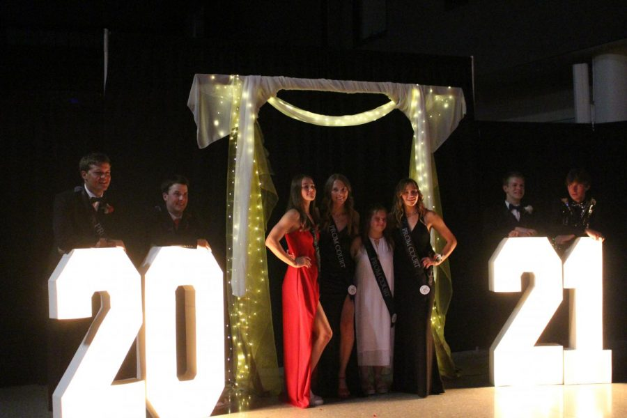 Prom court candidates pose together for a photo after Elizabeth Ash wins prom queen.