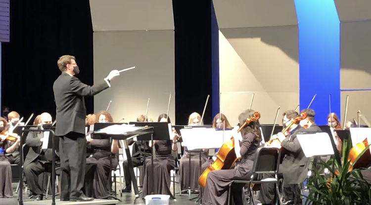Orchestra preforms The Owl Takes Flight, composed by senior Cameron Gurss.
