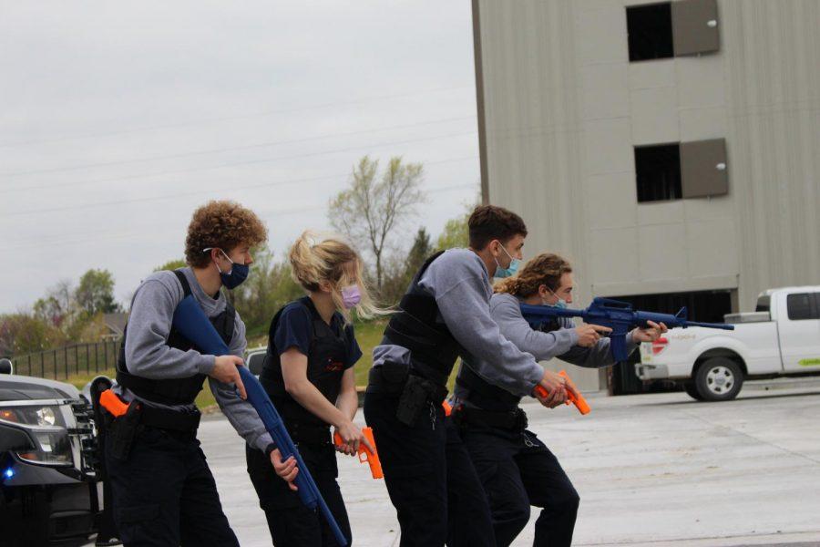 A Public Safety team advances on the suspect.
