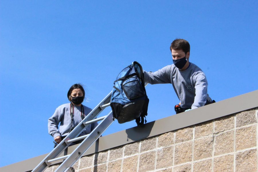 Seniors Ingrid Beltron and Cade Smith find evidence on the roof of storage building near the baseball fields.