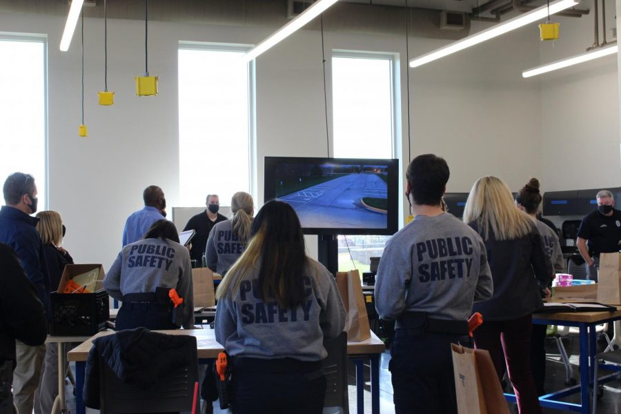 Students watch the surveillance footage in the Public Safety room.