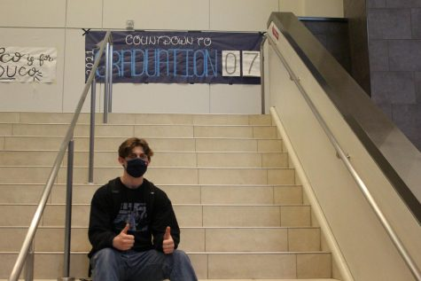 Senior Tyler Burkett sits on the stairs of the Main Entrance during his last week of high school.