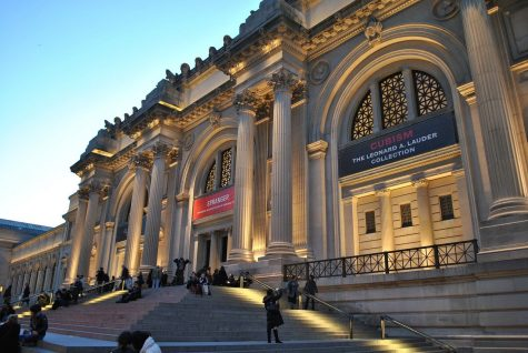 The Metropolitan Museum of art with its lights on in New York city.