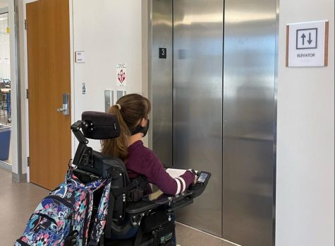 Sophomore Aubrey May waits for the elevator to take her to lunch